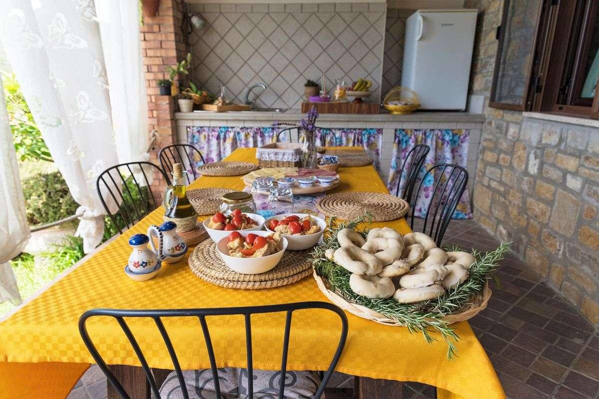 Il Brillocco Frühstückstisch auf der Veranda